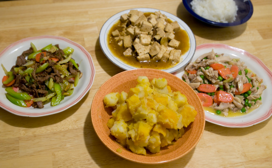 Beef Strips Stir Fried with Celery and Carrots, Potatoes and Pumpkin, Firm Tofu Stir Fried with Mushrooms, and Chicken with Peas and Carrots