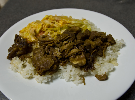 stewed pork, egg with tomatoes, and cabbage over rice