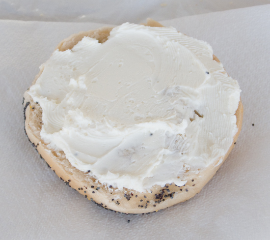 Half a Poppy Seed Bagel with Cream Cheese