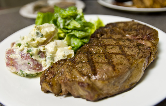 Dry Aged Rib Eye Steak with Potato Salad and Lettuce Salad