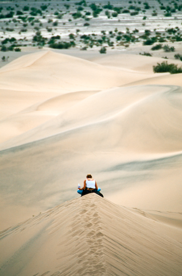 Woman Resting on Dune