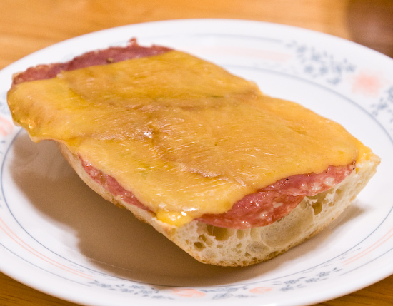 Open Faced Sandwich of Dry Salami and Sharp Cheddar