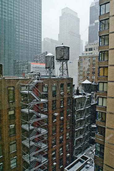 Snowing on a New York Fire Escape