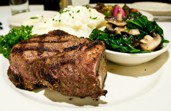 The Grill on the Alley - Bone-In Filet Mignon, Roasted Garlic Yukon Mashed Potatoes, Sauteed Spinach and Mushrooms