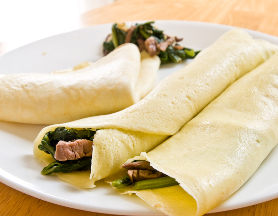 Crepes filled with turnip greens and beef