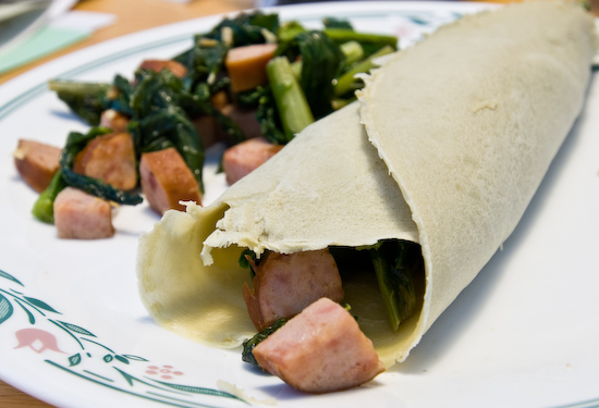 Crepes filled with turnip greens and sausage