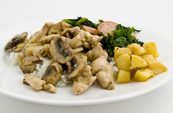 Leftover chicken and mushrooms, parsnip root, mustard greens with sausage over rice