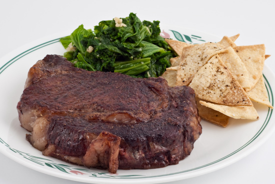 ribeye steak, mustard greens, tortilla chips