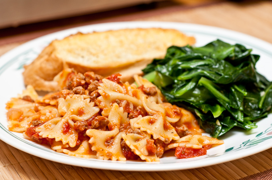 farfalle with meat sauce, collard greens, cheesy bread