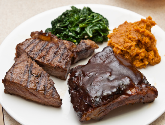 steak, ribs, mashed sweet potato, and turnip greens
