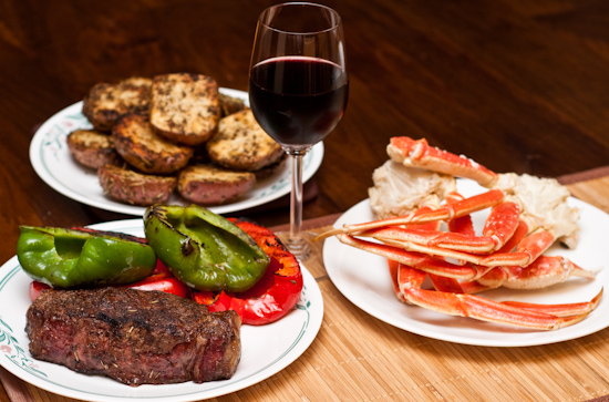 Surf and Turf Dinner: US Wellness Meats New York Strip Steak, Grilled Peppers, Red Potatoes, and Snow Crab Clusters
