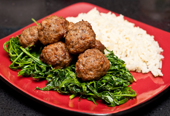 Aidells meatballs, sauteed arugula, and seasoned rice