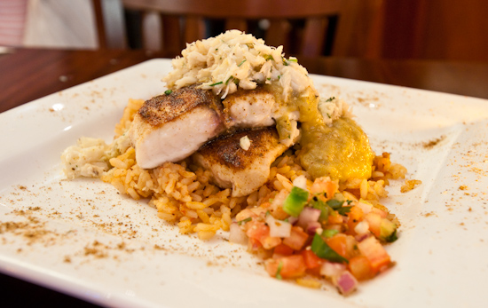 McCormick & Schmick's - Redfish Bronze Spiced over a Blue Crab Avocado Verde Sauce and Spanish Rice