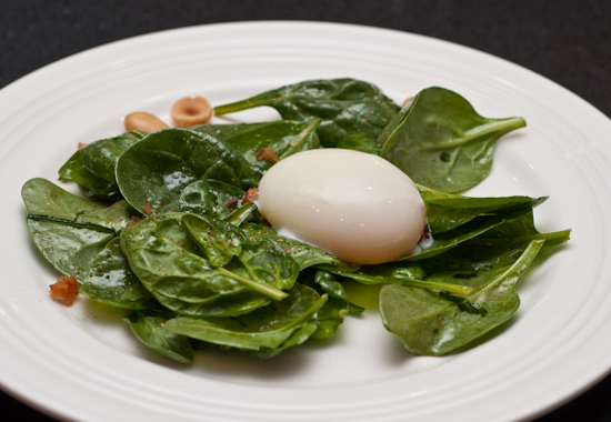 Wilted Spinach Salad with Shallots, Bacon, Marcona Almonds, and a 63 Degree Egg
