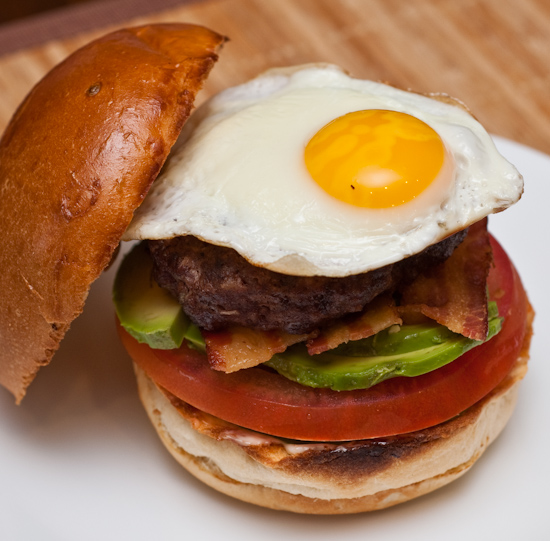 Homemade bacon cheeseburger with avocado and a fried egg