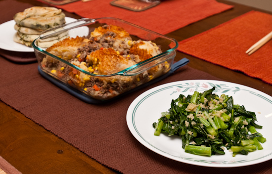 Cottage Pie with sauteed garlic collard greens and cong you bing