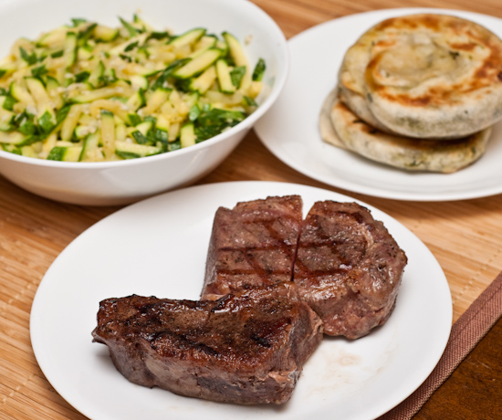 New York strip steak, zucchini, scallion pancakes