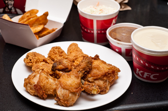 KFC - 10 pieces original recipe, mashed potatoes, cole slaw, potato wedges, and hot wings