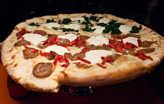 Home Slice Pizza - Large half white pie with spinach and half sausage, ricotta cheese and roasted red pepper pizza