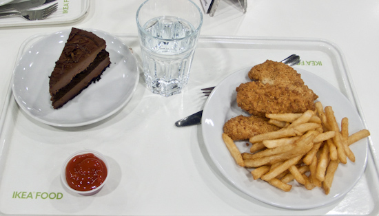 IKEA - chicken tenders with fries, and a slice of chocolate cake