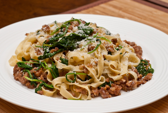Homemade fresh fettuccine with sausage and arugula
