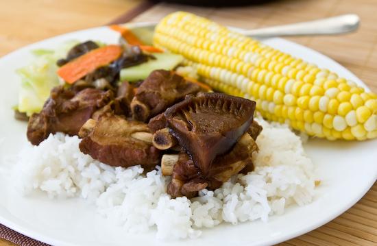 pork ribs, broccoli stems, and corn