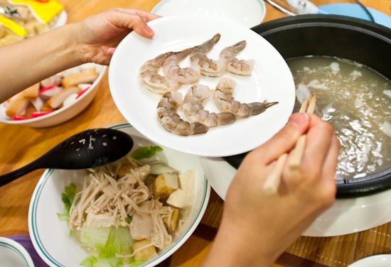 Adding shrimp to hot pot