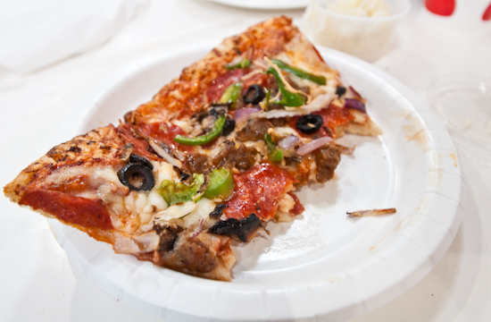 Costco - Half Eaten Combination Pizza Slice