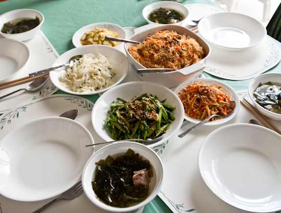 stir-fried rice noodles, asparagus, pork ribs and seaweed (konbu) soup, bean curd with carrots, pickled cucumbers, and vinegared potatoes
