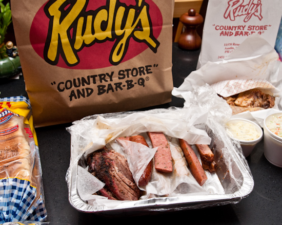 Rudy's BBQ - 1 lb moist brisket, 2 lb pork ribs, 1 jalapeno sausage, 1/2 chicken, potato salad, and cole slaw