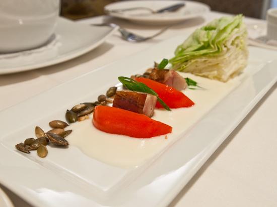 Zoot - Heirloom tomato salad with braised bacon, iceberg lettuce, pepitas and horseradish aioli