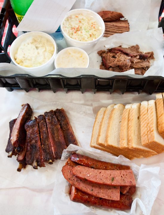 Rudy's BBQ - 1/4 pound lean brisket, 1/2 pound moist brisket, 1 pound ribs, 2 jalapeno sausage links, cole slaw, potato salad, and creamed corn