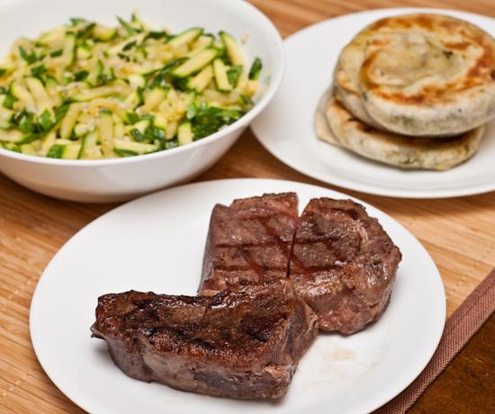 New York strip steak, zucchini, scallion pancakes