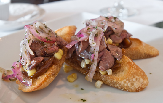 Zoot - Seared quail livers on toast with caramelized onion jam, sweet corn and fresh thyme