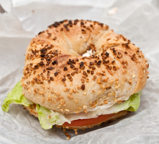 Absolute Bagels - Toasted Garlic Bagel with Lox Spread and Tomatoes and Lettuce