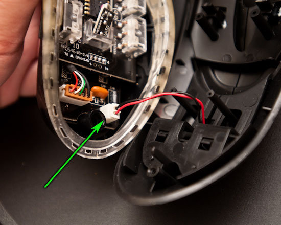 Unplug power cable to LED in hood